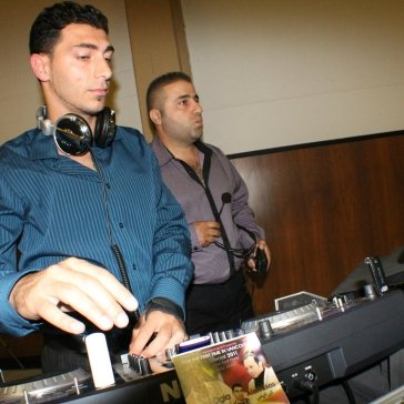 DJ Eddie at a Party with musician Faris
